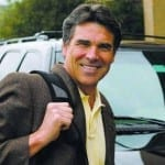 Rick Perry dressed casually with a backpack slung over his shoulder, standing in front of an SUV