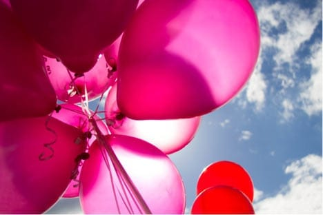 pink balloons in the sunshine